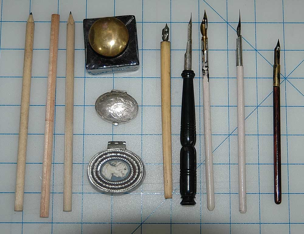 Various Writing Implements & Inkwells